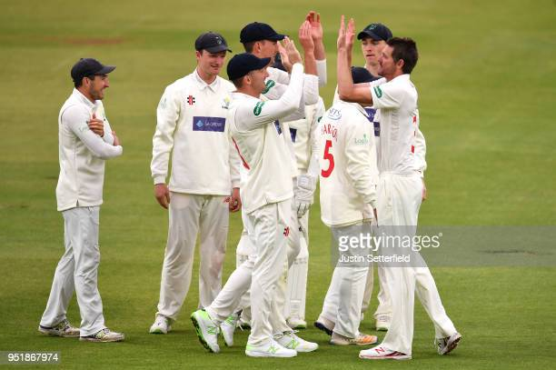 Michael Hogan of Glamorgan celebrates taking the wicket of Sam Robson of Middlesex during the Specsavers County Championship Division Two match...