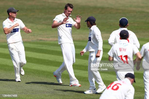 Michael Hogan of Glamorgan celebrates taking the wicket of Tom Fell of Worcestershire during day one of the Bob Willis Trophy Central Group match...