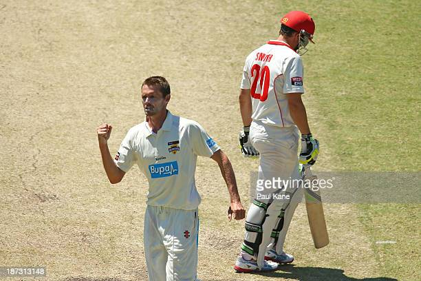 Michael Hogan of the Warriors celebrates the wicket of Kelvin Smith of the Redbacks during day three of the Sheffield Shield match between the...