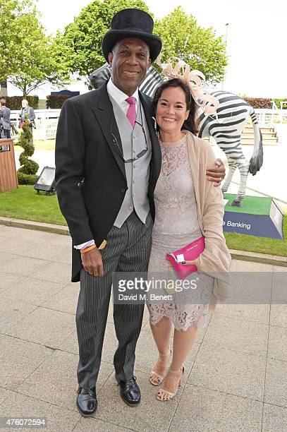 Michael Holding and LaurieAnn Holding attends Derby Day during the Investec Derby Festival at Epsom Racecourse on June 6 2015 in Epsom England