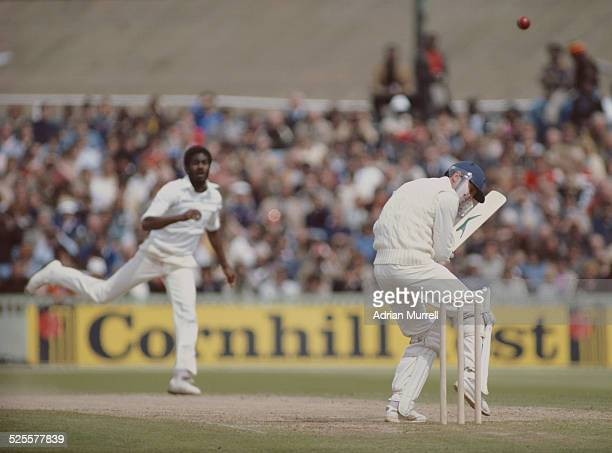 Michael Holding of the West Indies bowls a bouncer to Geoffrey Boycott of England during the third Cornhill test match on10 July 1980 at Old Trafford...