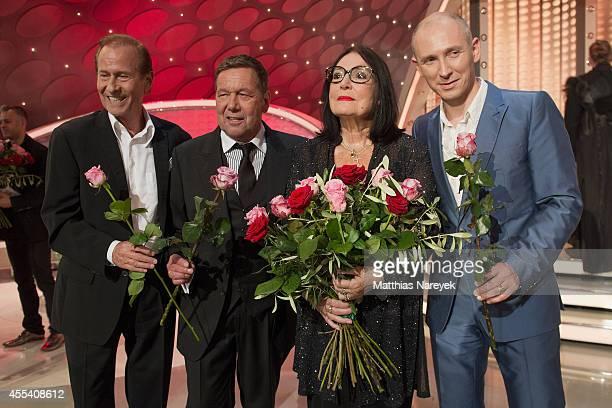 Michael Holm, Roland Kaiser, Nana Mouskouri and Helmut Lotti attend the 'Willkommen bei Carmen Nebel' show at Velodrom on September 13, 2014 in...