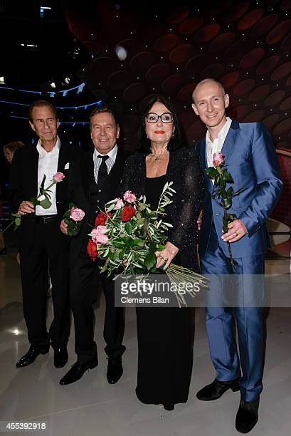 Michael Holm Roland Kaiser Nana Mouskouri and Helmut Lotti pose after the 'Willkommen bei Carmen Nebel' show at Velodrom on September 13 2014 in...
