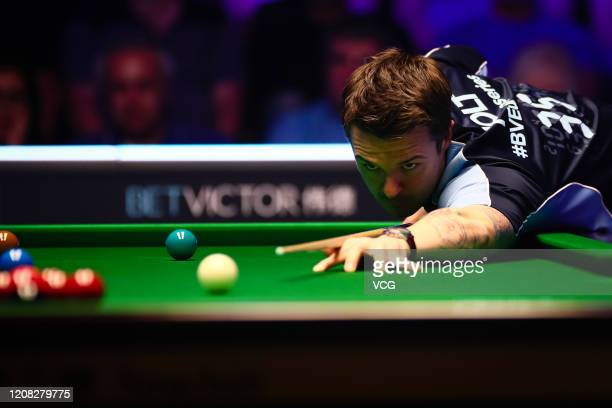 Michael Holt of England plays a shot during the semi-final match against Yan Bingtao of China on day four of the 2020 BetVictor Snooker Shoot Out at...