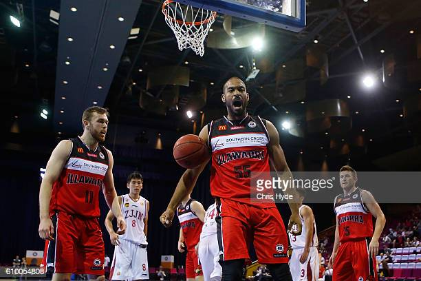 Michael Holyfield of the Hawks celebrates after a dunk during the Australian Basketball Challenge match between Zhejiang Gold Bulls and Illawarra...