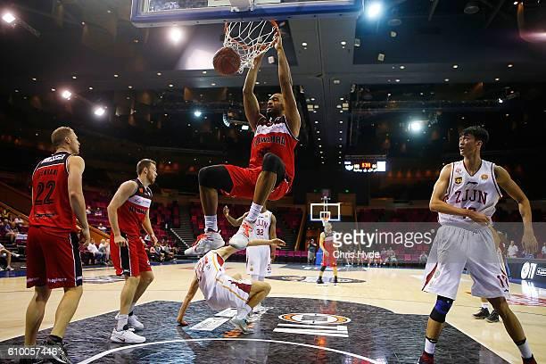 Michael Holyfield of the Hawks dunks during the Australian Basketball Challenge match between Zhejiang Gold Bulls and Illawarra Hawks at the Brisbane...