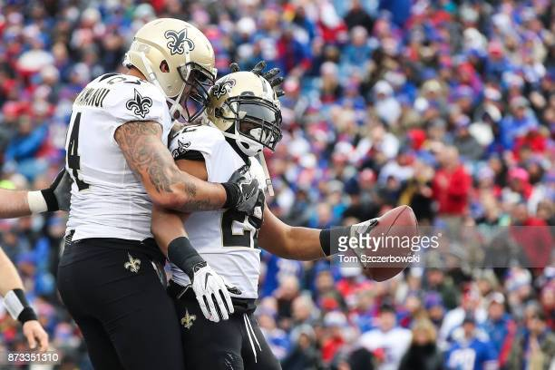 Michael Hoomanawanui of the New Orleans Saints celebrates with Mark Ingram of the New Orleans Saints after Ingram scored a touchdown during the...