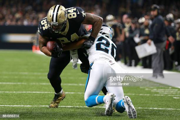 Michael Hoomanawanui of the New Orleans Saints is tackled by Kurt Coleman of the Carolina Panthers during the first half of a NFL game at the...