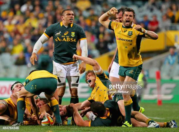 Michael Hooper and Adam AshleyCooper of the Wallabies celebrate victory at the final whistle as Bryan Habana of the Springboks looks on during The...
