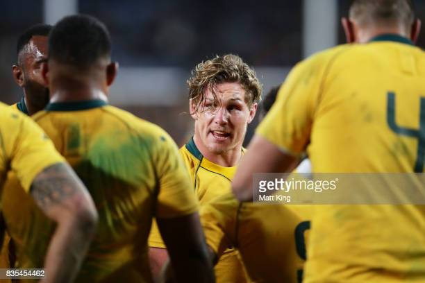 Michael Hooper captain of the Wallabies speaks to team mates after an All Blacks try during The Rugby Championship Bledisloe Cup match between the...