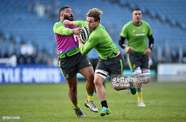 Michael Hooper of Australia hands off Silatolu Latu of Australia during an Australia training session at the RDS Arena on November 24 2016 in Dublin...