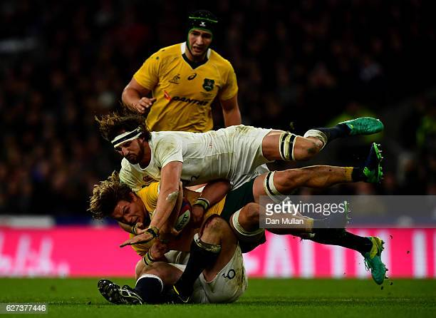 Michael Hooper of Australia is tackled by Tom Wood of England during the Old Mutual Wealth Series match between England and Australia at Twickenham...