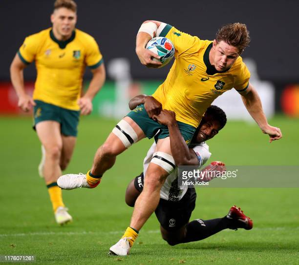 Michael Hooper of Australia is tackled during the Rugby World Cup 2019 Group D game between Australia and Fiji at Sapporo Dome on September 21, 2019...