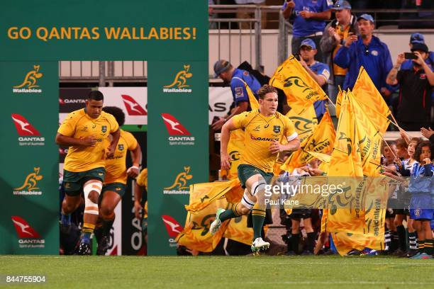 Michael Hooper of Australia leads the Wallabies out onto the field during The Rugby Championship match between the Australian Wallabies and the South...