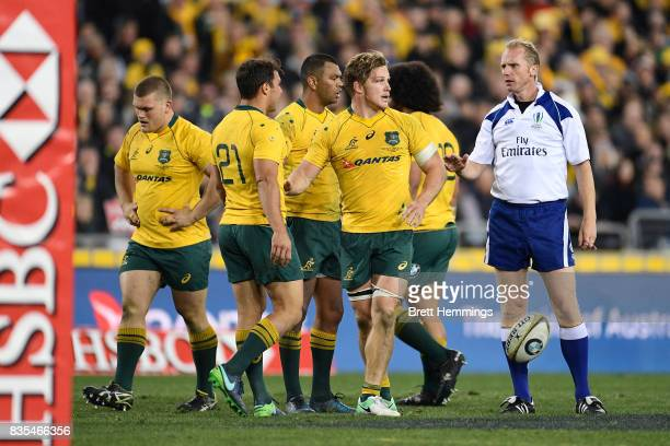 Michael Hooper of Australia pushes Nick Phipps of Australia away from referee Wayne Barnes during The Rugby Championship Bledisloe Cup match between...