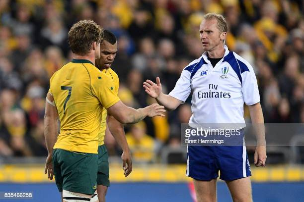 Michael Hooper of Australia speaks with referee Wayne Barnes during The Rugby Championship Bledisloe Cup match between the Australian Wallabies and...