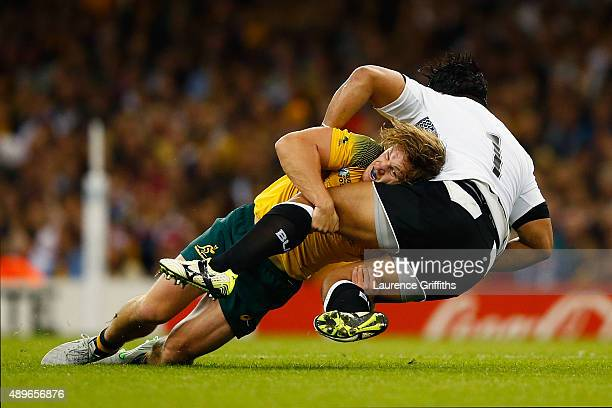 Michael Hooper of Australia tackles Campese Ma'afu of Fiji during the 2015 Rugby World Cup Pool A match between Australia and Fiji at the Millennium...