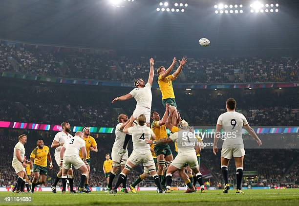 Michael Hooper of Australia wins the line out ball from Tom Wood of England during the 2015 Rugby World Cup Pool A match between England and...