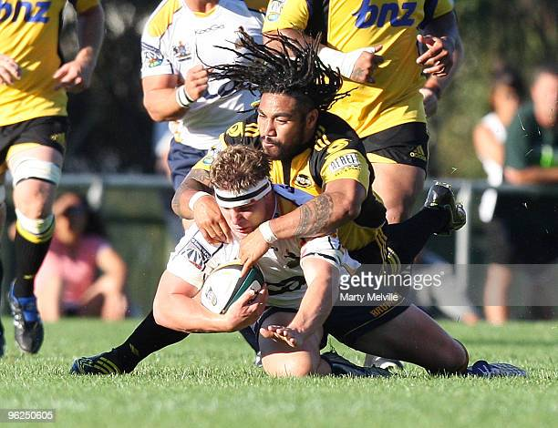 Michael Hooper of the Brumbies gets tackled by Ma'a Nonu of the Hurricanes during a Super 14 Trial match between the Hurricanes and the Brumbies at...