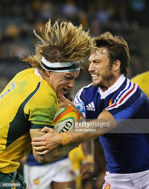Michael Hooper of the Wallabies is tackled by Maxime Medard of France during the second International Test Match between the Australian Wallabies and...