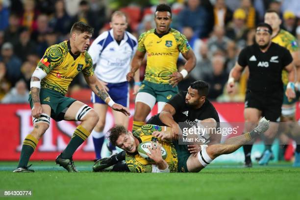 Michael Hooper of the Wallabies is tackled during the Bledisloe Cup match between the Australian Wallabies and the New Zealand All Blacks at Suncorp...