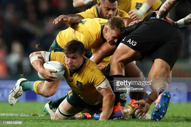 Michael Hooper of the Wallabies is tackled during The Rugby Championship and Bledisloe Cup Test match between the New Zealand All Blacks and the...
