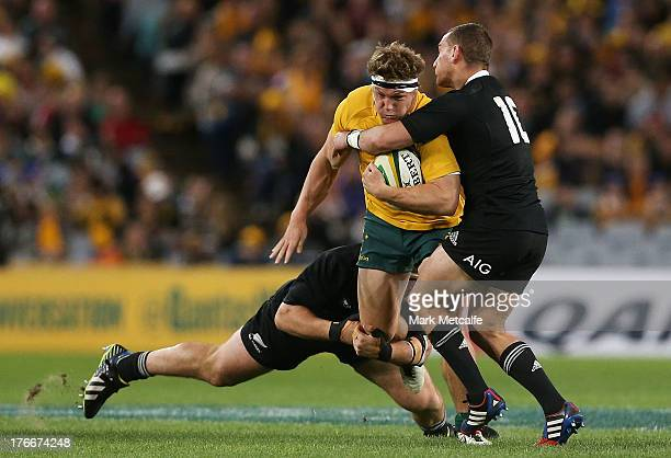 Michael Hooper of the Wallabies is tackled during The Rugby Championship Bledisloe Cup match between the Australian Wallabies and the New Zealand All...