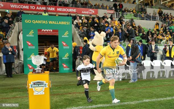 Michael Hooper of the Wallabies runs onto the field during the International test match between the Australian Wallabies and Ireland at AAMI Park on...