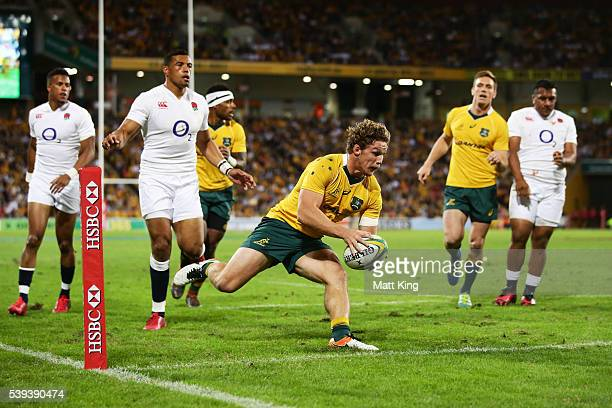 Michael Hooper of the Wallabies scores the first try during the International Test match between the Australian Wallabies and England at Suncorp...