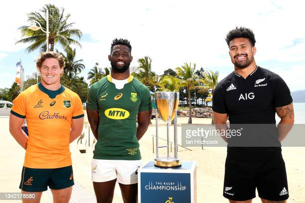Michael Hooper of the Wallabies, Siya Kolisi of the Springboks and Ardie Savea of the All Blacks pose with the Rugby Championship trophy during a...