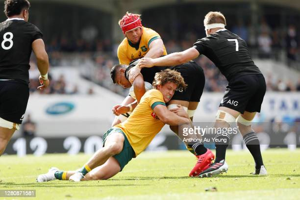 Michael Hooper of the Wallabies tackles Tupou Vaa'i of the All Blacks during the Bledisloe Cup match between the New Zealand All Blacks and the...