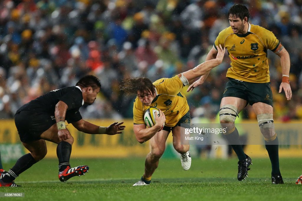 Michael Hooper of the Wallabies takes on the defence during The Rugby Championship match between the Australian Wallabies and the New Zealand All Blacks at ANZ Stadium on August 16, 2014 in Sydney, Australia.