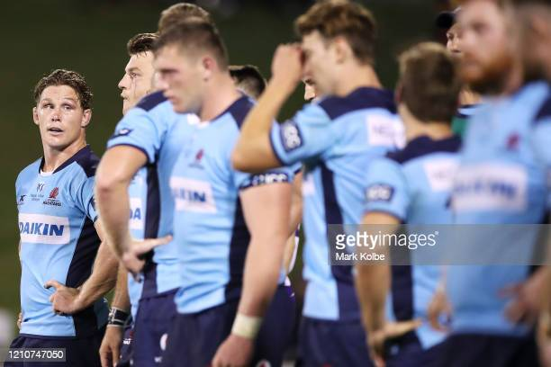 Michael Hooper of the Waratahs and his team look dejected after a Chiefs try during the round six Super Rugby match between the Waratahs and the...