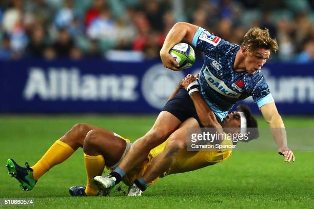 Michael Hooper of the Waratahs is tackled during the round 16 Super Rugby match between the Waratahs and the Jaguares at Allianz Stadium on July 8...