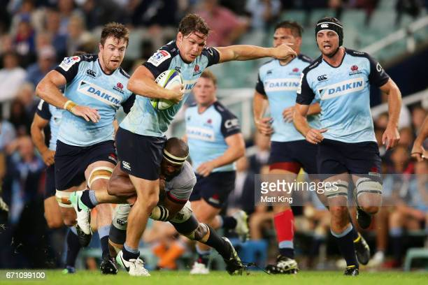 Michael Hooper of the Waratahs is tackled during the round nine Super Rugby match between the Waratahs and the Kings at Allianz Stadium on April 21...