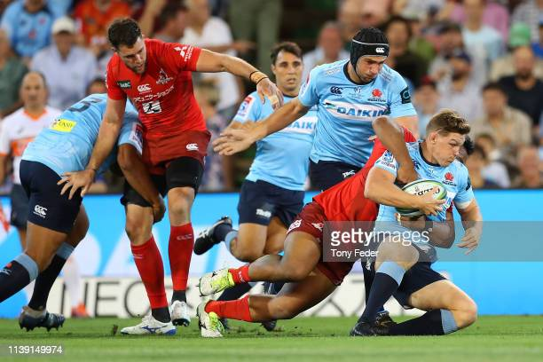 Michael Hooper of the Waratahs is tackled during the round seven Super Rugby match between the Waratahs and the Sunwolves at McDonald Jones Stadium...