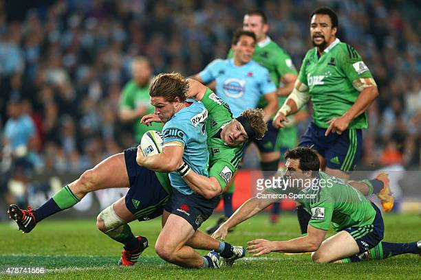 Michael Hooper of the Waratahs makes a break during the Super Rugby Semi Final match between the Waratahs and the Highlanders at Allianz Stadium on...