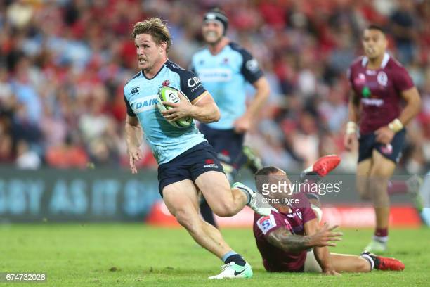 Michael Hooper of the Waratahs makes a break to score a try during the round 10 Super Rugby match between the Reds and the Waratahs at Suncorp...