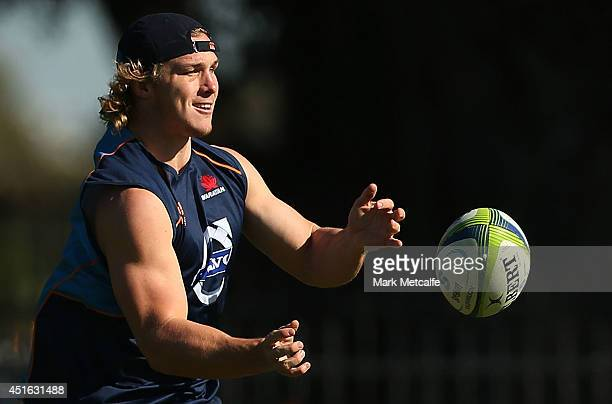 Michael Hooper passes the ball during a Waratahs Super Rugby training session at Kippax Lake on July 3 2014 in Sydney Australia