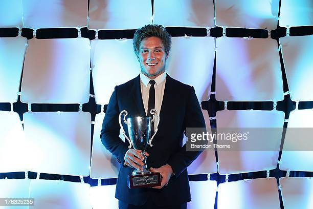 Michael Hooper poses with the Matthew Burke Trophy during the HSBC Waratahs Awards Dinner at The Ivy on August 29 2013 in Sydney Australia