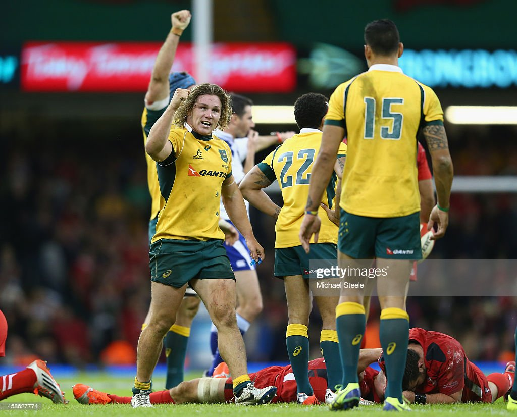 Michael Hooper (L) the captain of Australia celebrates his sides 33-28 victory on the final whistle during the International match between Wales and Australia at the Millennium Stadium on November 8, 2014 in Cardiff, Wales.
