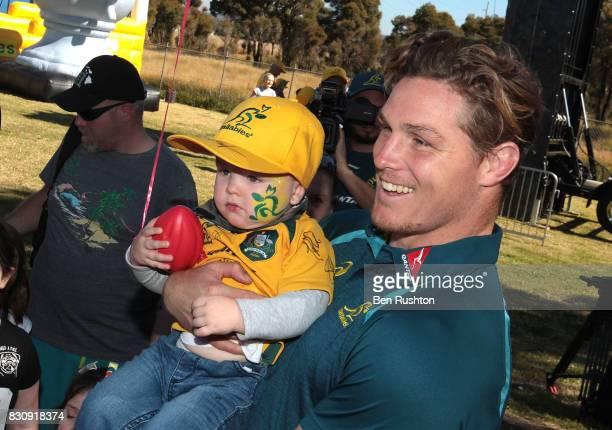 Michael Hooper with young Ellery Klaassen from Penrtih during an Australian Wallabies fan day on August 13 2017 in Penrith Australia