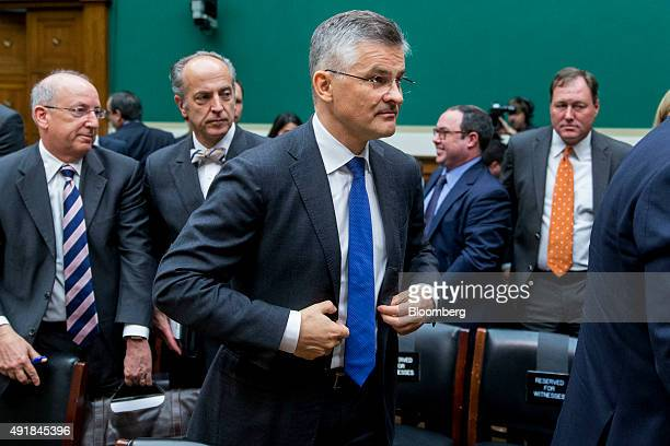 Michael Horn president and chief executive officer of Volkswagen of America Inc center walks out after testifying at a House Energy and Commerce...