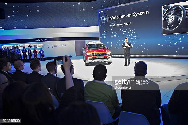 Michael Horn president and chief executive officer of Volkswagen Group of America speaks next to a Volkswagen Tiguan GTE Active concept during its...