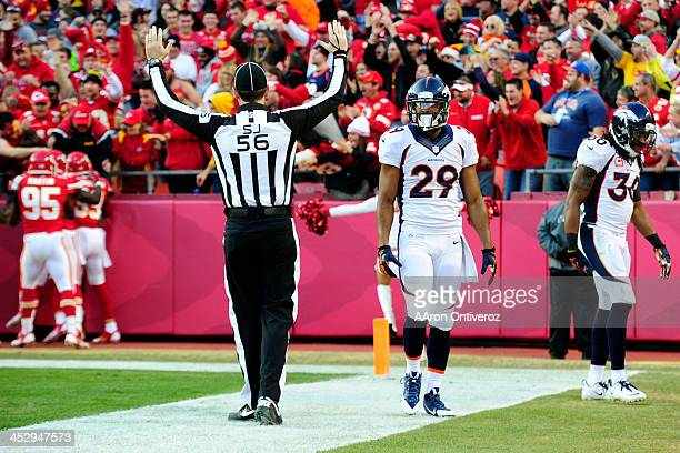 Michael Huff of the Denver Broncos and David Bruton of the Denver Broncos react after Knile Davis of the Kansas City Chiefs took a kickoff back for a...