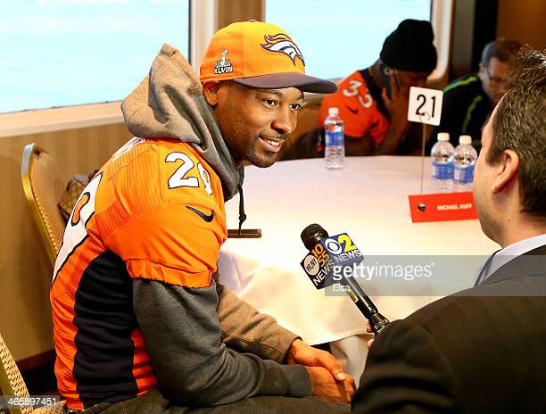 Michael Huff of the Denver Broncos talks to reporters during Super Bowl XLVIII media availability on January 30 2014 in Jersey City New Jersey The...