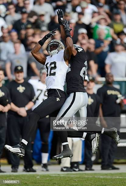 Michael Huff of the Oakland Raiders breaks up this pass to Marques Colston of the New Orleans Saints during the second quarter of their NFL football...