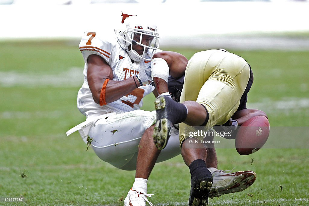 Michael Huff of the Texas Longhorns forces a fumble versus the Colorado Buffalos in the Big 12 Championship at Reliant Stadium in Houston, Texas on December 3, 2005. Texas won 70-3.