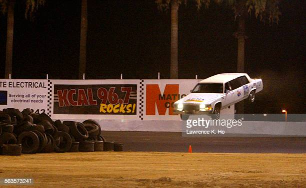 Michael Hughes attempting to break his own Guinness World Record for the longest ramp jump in a limousine at the Orange Show Speedway in San...