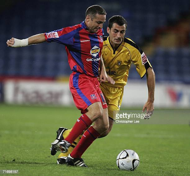 Michael Hughes of Crystal Palace battles with Mike Edwards of Notts County during the Carling Cup First Round match between Crystal Palace and Notts...